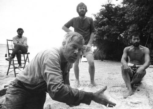 "celluloidshadows:  Director John Boorman watches as actors Lee Marvin and Toshiro Mifune map out a scene for the 1968 film ""Hell In The Pacific"". Click the pic to watch the movie in its entirety."