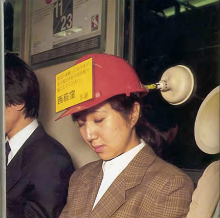 pajamaswag:   Helmet to prevent head from tilting while sleeping on train. The message board shows the station name for people to wake you up on time.  HOLY FUCK JAPAN IS SO CONVENIENT  HAHHAHAH WHAAAT I NEED THIS!
