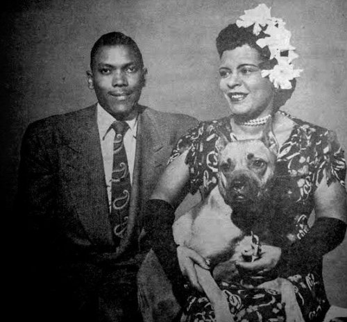 fuckyeahbillieholiday:  Lady with her then husband, trumpeter Joe Guy and Mister in her dressing room at the Downbeat Club in 1945.