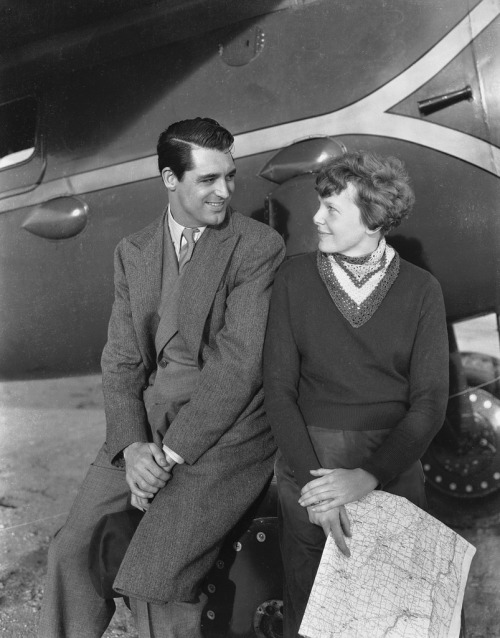 "hollyhocksandtulips:  Cary Grant and Amelia Earhart, 1934 Possibly a publicity photo for the Cary Grant/Myrna Loy aviation drama ""Wings in the Dark""."