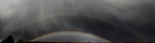 ikenbot:  Double Rainbow Panorama  Image & Summary: Jurgen de Boer  This double rainbow panorama was captured over Amersfoort, the Netherlands following a hail-producing afternoon thunderstorm. Clearly visible here are the primary and secondary rainbows, Alexander's dark band (the darkened area between the two bows) and supernumerary bows just beneath the top of the primary bow.
