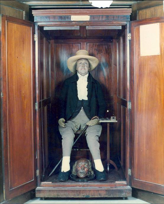 "Jeremy Bentham (1748 – 1832) was an English author, jurist, philosopher, and legal and social reformer. He is best known for his advocacy of utilitarianism and animal rights, and the idea of the panopticon. As requested in his will, Bentham's body was dissected as part of a public anatomy lecture. Afterward, the skeleton and head were preserved and stored in a wooden cabinet called the ""Auto-icon"", with the skeleton stuffed out with hay and dressed in Bentham's clothes. Originally kept by his disciple Thomas Southwood Smith, it was acquired by University College London in 1850. It is normally kept on public display at the end of the South Cloisters in the main building of the college, but for the 100th and 150th anniversaries of the college, it was brought to the meeting of the College Council, where it was listed as ""present but not voting"". Bentham had intended the Auto-icon to incorporate his actual head, mummified to resemble its appearance in life. However, Southwood Smith's experimental efforts at mummification, although technically successful, left the head looking distastefully macabre, with dried and darkened skin stretched tautly over the skull. The Auto-icon was therefore given a wax head, fitted with some of Bentham's own hair. The real head was displayed in the same case as the Auto-icon for many years, but became the target of repeated student pranks. It is now locked away securely."