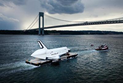 Enterprise Shuttle beneath the span of the Verrazano-Narrows Bridge in New York City on June 3, 2012, on its way to its new home at the Intrepid Sea, Air and Space Museum