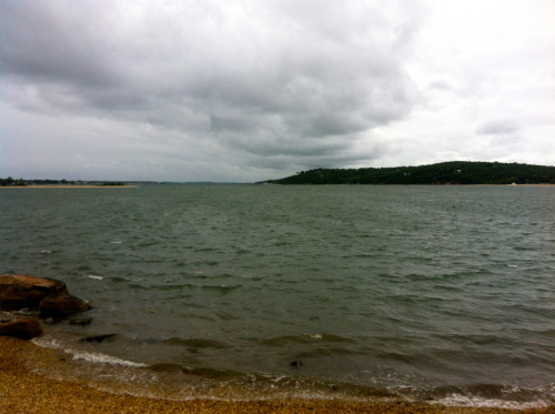 Photo a Day: Day 59. This photo is of the water looking toward the North Fork of Long Island, NY from Shelter Island, NY. It was a very windy, overcast day, but you can't really see how windy it was in the picture, but what you can see are some gusts, or faster moving sections of wind on the water. The darker patches on the water are gusts of wind racing toward me.