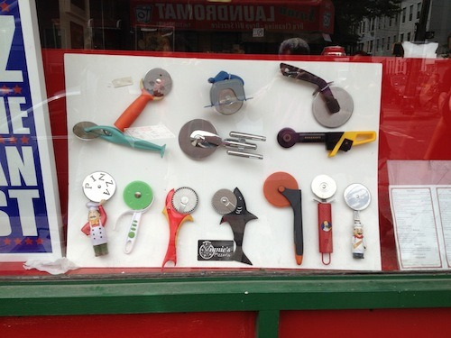 Rad pizza slicer collection at Vinnie's Pizzeria in Greenpoint, Brooklyn! They have funky pizza options and lots of selections for vegans!