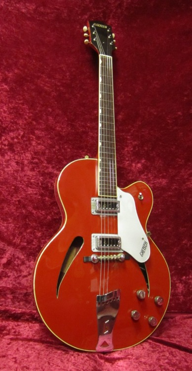 "Gretsch 6117 Catseye 1964-1968Maple, Mahogany, Rosewood As cool as it is rare, the Gretsch 6117 Catseye got its name from the ""Cat eyed"" shape sound holes instead of the traditional F-holes. Common to Rickenbacker, catseye holes were only seen in acoustic Gretsch models. Known colors are black, candy apple red, and an extremely rare metallic blue. Edit: Sam Ash had apparently a 1964 exclusive in Monkee's red (pictured)"