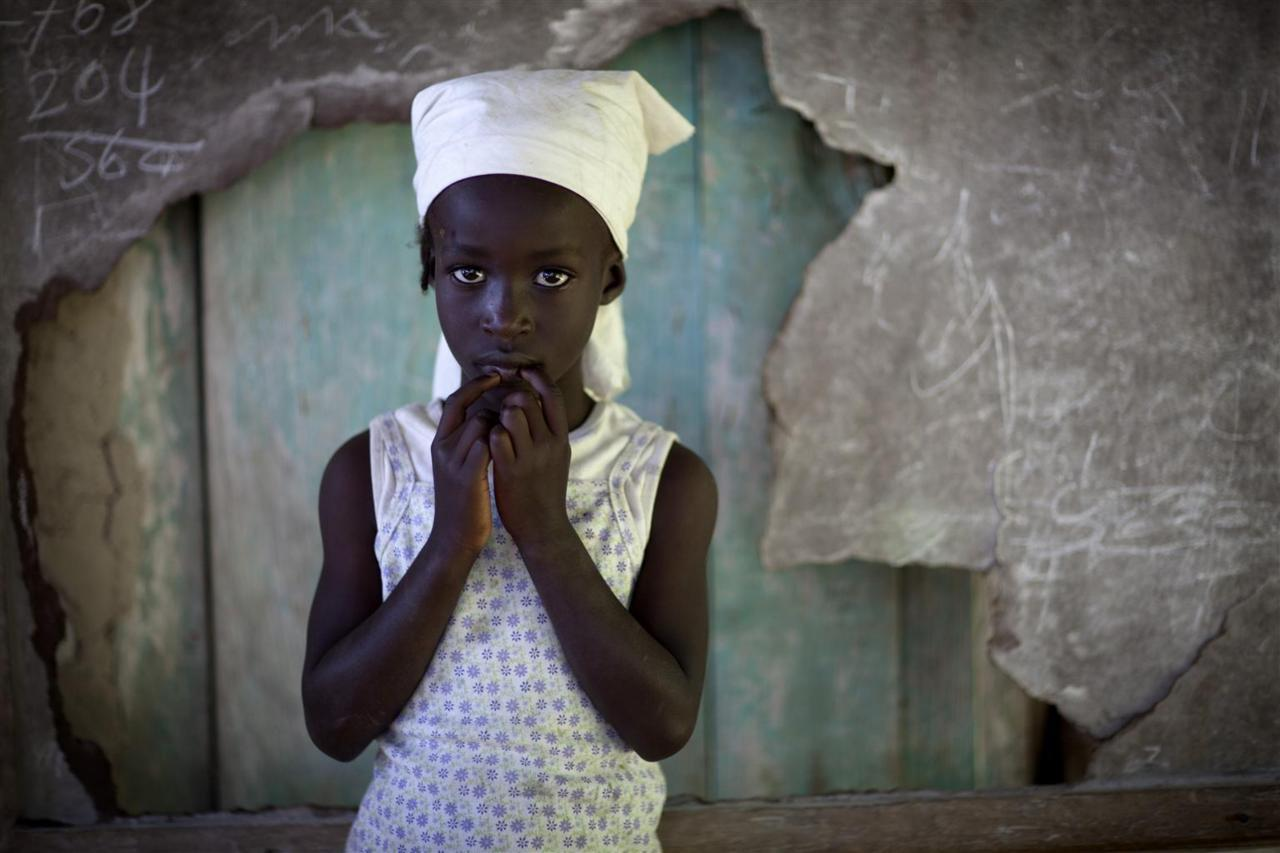unicef:  A girl stands in front of a broken chalkboard at a school in Pyechal, a mountainside village in the Department of Sud-Est, Haiti. She participated in a UNICEF-supported programme to promote local, sustainable solutions for improved sanitation to prevent the spread of diseases and illnesses, such as cholera and diarrhoea. Haiti and its approximately 4.3 million children continue to recover from the 12 January 2010 earthquake. Progress has been substantial: a new national government is in place; about half of the mounds of rubble have been cleared; almost two thirds of those displaced by the quake have moved out of crowded camps; and the country's health, education and other core services are being rebuilt on a stronger foundation. Still, the country remains a fragile and impoverished state, requiring international support. Working with multiple international and national partners, UNICEF continues to address the emergency needs of children, while focusing on building the Government's capacity to uphold and sustain children's rights. © UNICEF/Dormino http://www.unicef.org