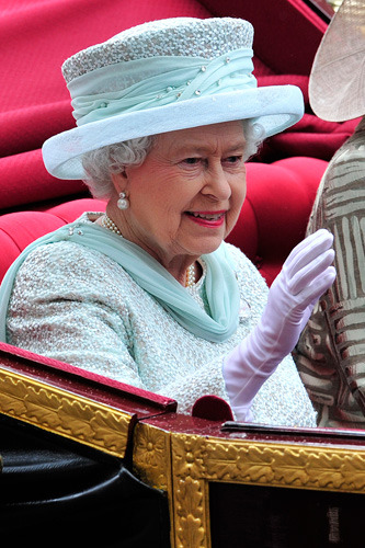 Photo Credit: Glyn Kirk/AFP/GettyImages Securitise the Queen By: Brett Scott Times of economic stress call for creative solutions, and on this Diamond Jubilee I think it's fitting to celebrate the Queen by using her for some first-rate financial engineering. I think it's time the UK government started issuing MBS. Yes, Monarch-Backed Securities. Monarch-backed securities are innovative new financial instruments that will securitise the Queen, using her as collateral against which the government can borrow money. Traditionally, government debt was thought to be so safe that it was considered risk free, but we don't really believe that any more – Queenie would be doing the UK a great favour if she was put up as collateral, extending the Royal favour of lowering the UK's cost of borrowing. Property is normally the thing people use for loan collateral, because it's big and solid, but Queenie is infinitely more solid than property (Indeed, her predecessors basically invented the concept of private property back in the enclosure movement).