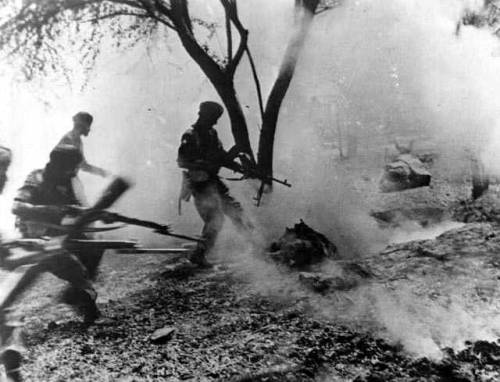 British Indian Army soldiers capture an entrenched German position.
