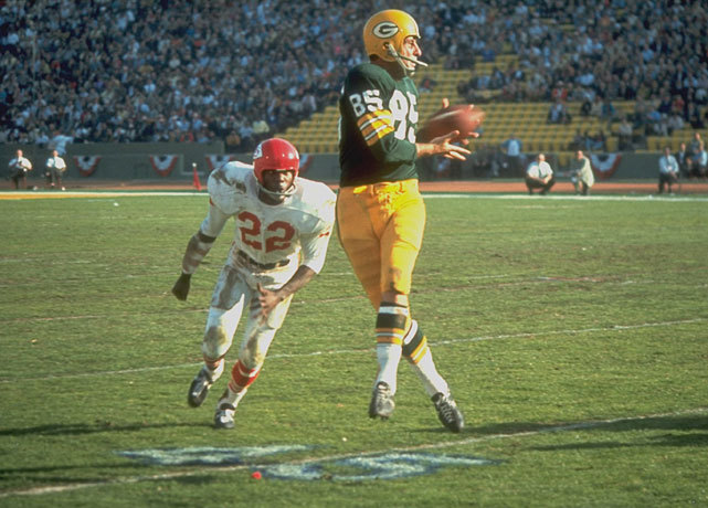 Packers receiver Max McGee makes a catch on Chiefs safety Willie Mitchell during Super Bowl I. McGee caught seven passes for 138 yards and two touchdowns in leading Green Bay to a 35-10 victory. (Walter Iooss Jr./SI)  SI VAULT: Packers turn first Super Bowl into runaway victory (1.23.67)GALLERY: Classic Photos of the Green Bay Packers