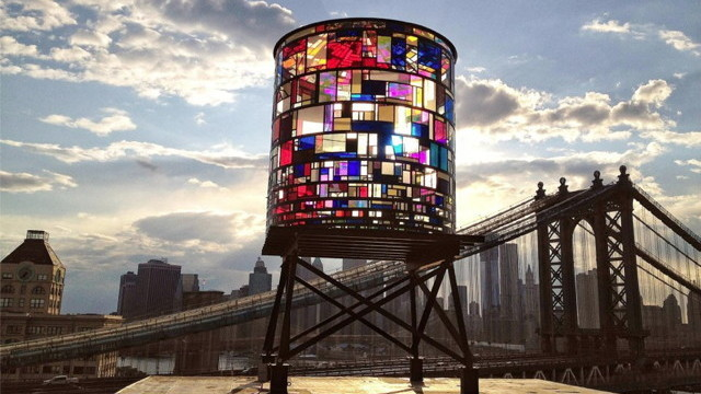 minusmanhattan:  Watertower by Tom Fruin is composed of 1,000 pieces of salvaged NYC plexiglas and sits in DUMBO, Brooklyn.  According to Gizmodo:  Beginning June 7th, the tower will be lit from within by digitally-controlled light sequences playing from dusk till morning for a full year. A welcome addition to Brooklyn's skyline, Watertower will be visible from Lower Manhattan, FDR Drive, and the Manhattan and Brooklyn Bridges at night.  Photos by Robert Banat.