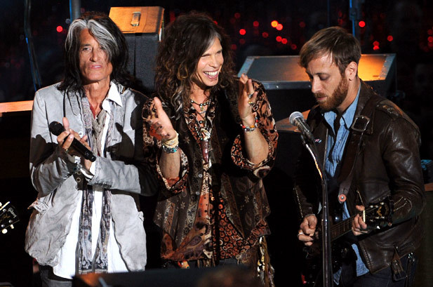June 3: Joe Perry, Steven Tyler, and Dan Auerbach from the Black Keys speak onstage during the 2012 MTV Movie Awards in Universal City, California. (You guys know that I'm a huge fan of the Black Keys and I love Aerosmith as well so this picture is pretty freakin' dope to me! xo @RozOonTheGo)
