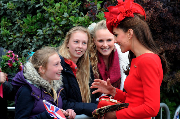 Catherine, Duchess of Cambridge meets well-wishers before boarding the royal barge 'Spirit of Chartwell' for the Thames Diamond Jubilee Pageant on the River Thames in London, on June 3, 2012. Hundreds of rowing boats, barges and steamers filled the River Thames with a blaze of colour on Sunday as Queen Elizabeth II sailed through London as part of her spectacular diamond jubilee pageant.