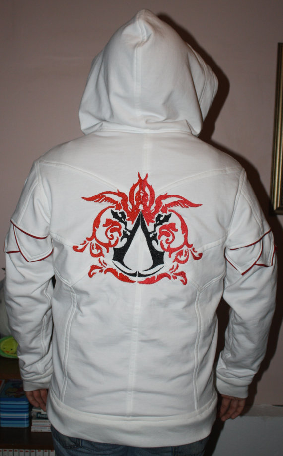 shayraeingame:  otlgaming:  HANDCRAFTED HOODIES I love hoodies. I love video games. When someone puts them together like India Atkinson, I'm in love. This designer deserves a fraking award because her hoodies are so beautiful and detailed. The hoodies are a bit expensive but just look at that craftsmanship. She definitely needs to submit her hoodie ideas to a gaming studio like the Mass Effect hoodie concept because she is far too talented for studios not to know about her work.  Hoodies by India Atkinson (via pwnlove) || (via FashionablyGeek)  These are SO adorable. But there is no way in Helllllllllllllllll I am paying $275 for a hoodie.