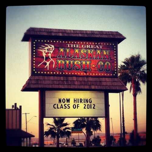 A strip club sign