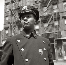 Law and Order William Alexander Frazier (Policeman no. 19687), born 1916 in Harlem Photographer: Gordon Parks Harlem, New York, USA, 1943.