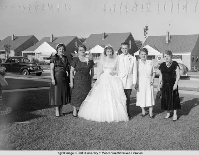 Bride and groom with family, Milwaukee, Wisconsin, ca. 1940. An unidentified couple poses with family members—probably mothers and aunts—on the front lawn of a home in what is most likely a working-class neighborhood on Milwaukee's south side. This photo was taken by Dennis Wierzba, an amateur photographer who documented social events and family gatherings in Milwaukee in the 1940s and 50s. via: Milwaukee Neighborhoods: Photos and Maps 1885-1992, University of Wisconsin-Milwaukee Libraries