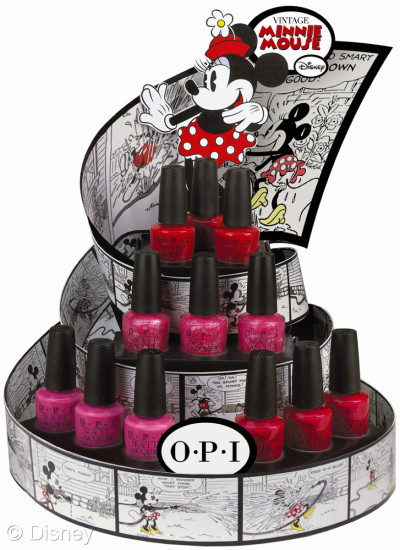 heckyeahdisneymerch:  OPI launches Vintage Minnie Mouse, including four limited edition nail lacquers, for summer. Created in honor of Disney's beloved character, the colors encapsulate Minnie Mouse's irresistible charm in playful, pretty shades of pink and red. The line features a pink crème lacquer, one frosted red shade, a shimmery fuchsia, and a heart glitter confetti: Nothin' Mousie 'bout It – Don't squeak it – SHOUT IT! This confetti light pink is tops! I'm All Ears – Tell me how much you love this magenta shimmer. If You Moust You Moust - You gotta pink what you gotta pink. The Color of Minnie – You had this little mouse at 'red.' his limited edition promotion will be available beginning June 2012 at professional salons, including Beauty Brands, Beauty First, Chatters, Dillard's, JCPenney, Pure Beauty, Regis, Trade Secret, and ULTA, for $8.50 ($9.95 CAN) suggested retail for each Nail Lacquer. -From Stitch Kingdom