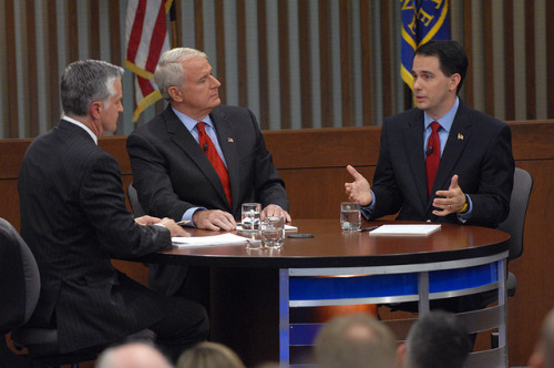 Wisconsin recall roundup: Tom Barrett vs. Scott Walker It's election time! Today will mark the third time in history that a US state heads to the polls to with the potential of firing a sitting governor. The saga began with Governor Scott Walker's controversial budget repair bill in 2011, and will come to an end today (well, at least symbolically). In case you're rusty on who's running and why, here's the skinny on the two major-party candidates. The ChallengerDemocrat Tom Barrett, a former attorney, served in the Wisconsin state legislature, the US House of Representatives, and is currently Mayor of Milwaukee. He's a member of the multi-party Mayors Against Illegal Guns coalition and was once beaten and permanently injured while responding to a woman's cries for help (this was when he was mayor, mind you). Barrett lost to Scott Walker two years ago in the governor's race; the day that the state of Wisconsin approved the recall elections, Barrett declared his candidacy. The IncumbentRepublican Scott Walker entered the state legislature the year Barrett left, and served as Milwaukee County Executive before winning the governorship in 2010. He's most well-known for having championed controversial legislation last year that restricted collective bargaining rights for state employees. Wisconsin Democrats hated the bill so much, they fled the state, and there were nationwide protests against it. Walker's vocal support for that bill, which eventually passed, was the impetus for the recall election. source » So who's gonna win? It's extremely close right now. Public Policy Polling's most recent poll shows Walker ahead by three points, but Barrett closing the gap and within the margin of error. So it could go either way; it all depends on voter turnout. (So vote!) We'll be covering it tonight, folks — we'll keep you posted. (photo via WisPolitics.com, from last week's debate) Follow ShortFormBlog: Tumblr, Twitter, Facebook