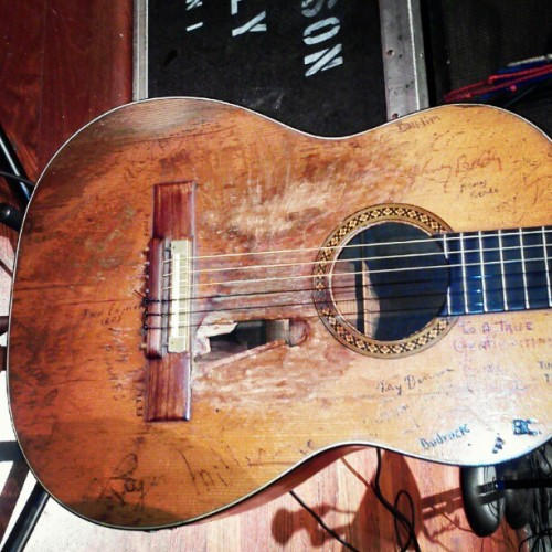 Willie Nelson's guitar.  Dozens of signatures on it and so beat up it has a giant hole in the body.  #legendary (Taken with Instagram at Schermerhorn Symphony Center)