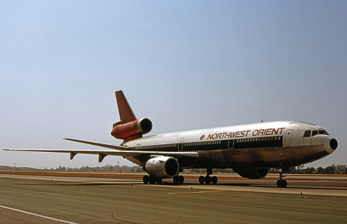 Northwest Orient, McDonnell Douglas DC-10-40 by Ron Monroe on Flickr.Via Flickr: LAX July, 1980 Northwest opted for the P&W JT9D engines used by their 747s, rather than the usual GE CF-6s. The P&W required a different cowling, that is most noticable with the center engine. There, you can see a bulge on the straight-through inlet, only found with the JT9D. Northwest Orient Airlines became Northwest Airlines after its merger with Republic Airlines on Oct. 1, 1986.