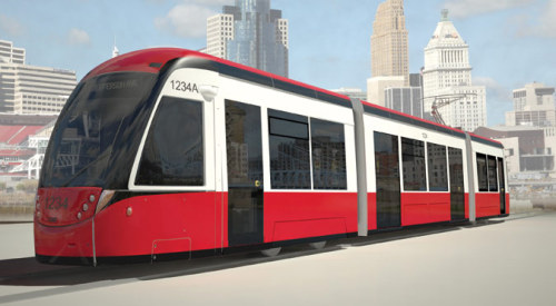 """RAILVOLUTION! Cincinnati plans for more streetcars while constructing its first route. Steven Vance. June 1, 2012 In his seventh State of the City address on April 10, Cincinnati Mayor Mark Mallory talked about the streetcar the city had started building in February, introducing the subject with, ""And you all know that I could not let you out of here tonight without talking about the streetcar."" Mallory linked the streetcar creation to a strategy to help the city thrive. He also laid out a vision for a much larger rail transit system. Building the first line took persistence. Hamilton County voters rejected a proposed plan for improved and expanded transit in 2002. Then ballots in 2009 and 2011 tried to block the city from building streetcars. Both failed. Part of the city's marketing message for the rail network is that the streetcar system will attract new businesses. An economic development study the city commissioned found that property values would be greater and emissions and pollution reduced. The study also found savings in congestion and reductions in crashes when people choose to take a streetcar over their personal automobiles.  The city government is leading the planning and construction of the streetcar system, and Metro, the local transit agency, will operate it. The route will reach from downtown to Over-The-Rhine Historic District, making 18 stops in its roundtrip journey. The construction costs are estimated to be $99.5 million plus utility relocation. A fare price hasn't been determined.  The April speech brought more specifics: Mallory announced that the city selected CAF USA to design and manufacture the trains and showed renderings of the proposed design. Attractive trains aren't the only outcome of a good transit system. Mobility and connections are key, so Mallory described a second route in Uptown, for which the city is seeking $1.2 million in federal New Starts funds for a study.  The city's vision doesn't end with light rail. Mallory mentioned using light rail alongside two highways and commuter rail (faster trains covering longer distances) for other corridors. These efforts will require regional cooperation, said Meg Olberding, spokesperson in the city manager's office. ""The Ohio-Kentucky-Indiana Regional Council of Governments has long-range planning tools and would pull together our partners, including Hamilton County, Metro, and the state and federal Departments of Transportation."" Though Ohio Governor John Kasich refused federal funds to plan for and construct high-speed rail lines in the state, Mallory will push forward: ""I do not believe that we should give up on the idea of high-speed rail in this state."" Via: The Architect's Newspaper Image: City of Cinncinati"