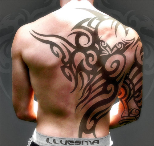 9tattoos:  Tribal tattoos look great on muscular man!  For more awesome tattoos visit us every day.  Want