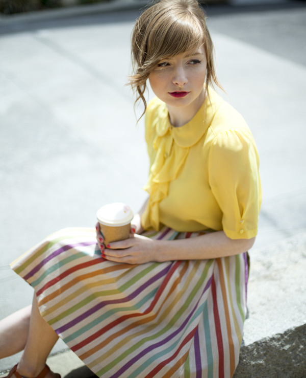 modcloth:  ModEmployee Sam sitting pretty with a fresh cup of coffee in San Francisco. Like her look? Shop our Fog City Faves»