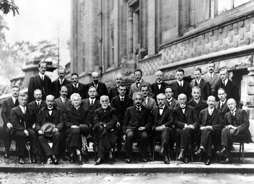 Solvay Conference, 19271927 Solvay Conference on Quantum Mechanics. Photograph by Benjamin Couprie, Institut International de Physique Solvay, Brussels, Belgium.  From back to front and from left to right : Auguste Piccard, Émile Henriot, Paul Ehrenfest, Édouard Herzen, Théophile de Donder, Erwin Schrödinger, Jules-Émile Verschaffelt, Wolfgang Pauli, Werner Heisenberg, Ralph Howard Fowler, Léon Brillouin, Peter Debye, Martin Knudsen, William Lawrence Bragg, Hendrik Anthony Kramers, Paul Dirac, Arthur Compton, Louis de Broglie, Max Born, Niels Bohr, Irving Langmuir, Max Planck, Marie Skłodowska Curie, Hendrik Lorentz, Albert Einstein, Paul Langevin, Charles Eugène Guye, Charles Thomson Rees Wilson, Owen Willans Richardson