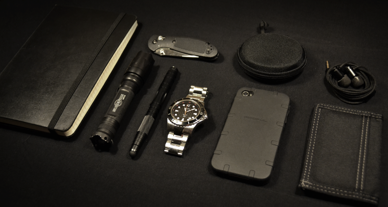 EDC By: Wally (High Res) Moleskine - Purchase on Amazon SureFire E2D - Purchase on Amazon Smith & Wesson with Stylus Tip - Purchase on Amazon Benchmade Mini Griptillian - Purchase on Amazon Bulova Men's Marine Star - Purchase on Amazon Cosmos Case w/ Paracord Pull - Purchase on Amazon Magpul iPhone 4/4S Field Case - Purchase on Amazon iPhone 4s - Purchase on Amazon Munitio [M] BLK Nine Millimeter Earphones - Purchase on Amazon Maxpedition Micro Wallet - Purchase on Amazon