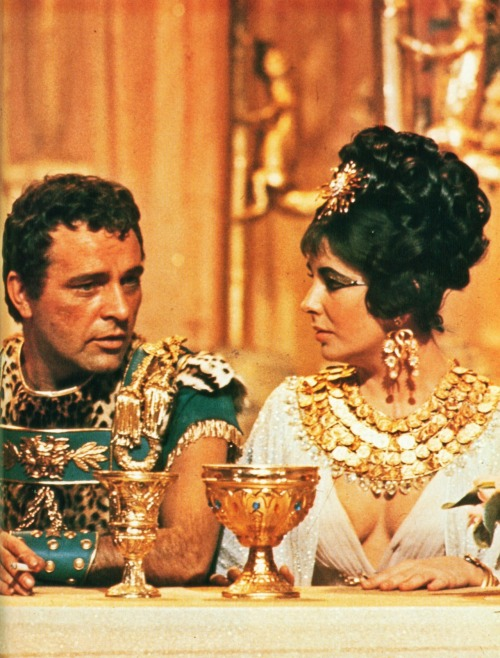 updownsmilefrown:  Elizabeth Taylor chats with her soon-to-be fifth husband, Richard Burton, during a time-out in the filming of Cleopatra, 1962 by Paul Schutzer