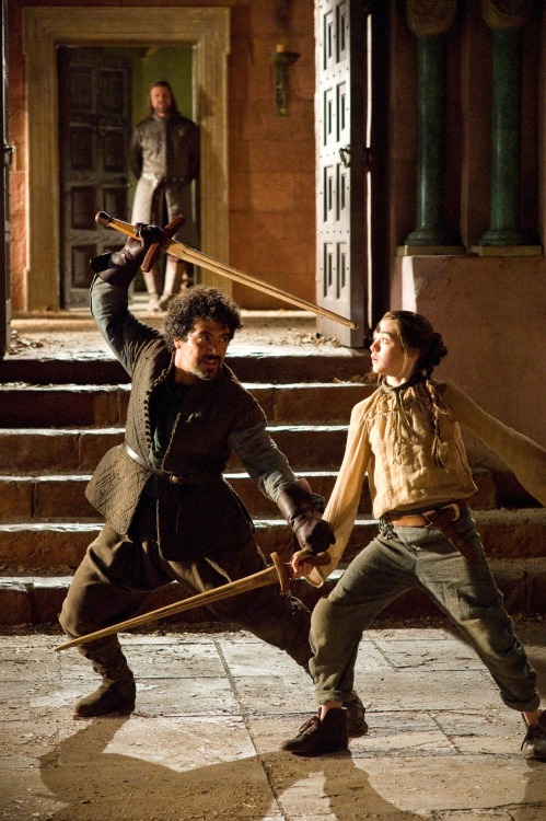 """Syrio Forel"" (Miltos Yerolemou) and ""Arya Stark"" (Maisie Williams) in Game of Thrones Costume design by Michele Clapton"