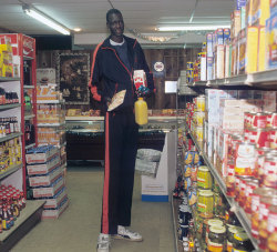 siphotos:  University of Bridgeport center Manute Bol goes shopping for groceries. (Jacqueline Duvoisin/SI)  GALLERY: Rare Photos of Manute Bol   Holy shitt!!