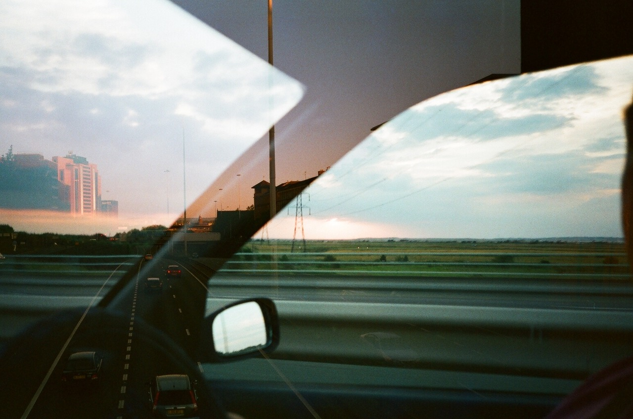 acidmist:   Last week I shot a roll of film that I'd got free with a second hand camera. When I got back the scans I found out that the roll had already been used by the guy who gave me it and so I had double exposed it. By chance, both of us had taken a photo of a motorway landscape and this was made. His photo is from the inside of the car looking at countryside and my shot of an urban motorway is best seen on the left hand side.  This is fucking amazing