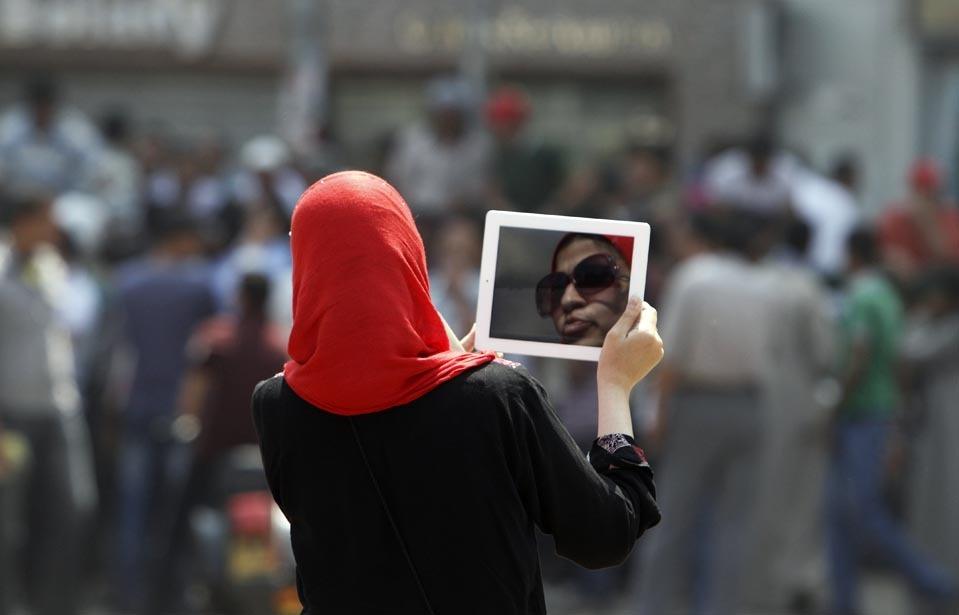 "thepoliticalnotebook:    Picture of the Day: Cairo, Egypt. A woman captures video footage of protests in Tahrir Square on Monday using her tablet computer. Read: A very interesting piece by Amro Ali in Jadaliyya titled ""Saeeds of Revolution: De-Mythologizing Khaled Saeed,"" which urges a clear and accurate representation of the young martyr who has such powerful symbolism within Egypt's revolutionary politics. Credit: Mohammed Abed/AFP/Getty. Via. View more Picture of the Day posts. Submit a photo."