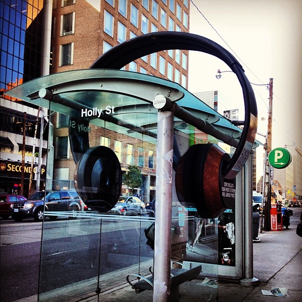 smilenaked:  #ttc #headphones #busshelter (Taken with instagram)