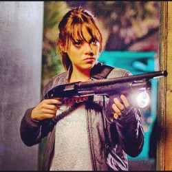 That's one sexy woman with a gun right there! #hollywood #movie #zombie #zombieland #iphone #gun #army #emmaStone #girl #actress #actor #movie #tv #show #television (Taken with instagram)