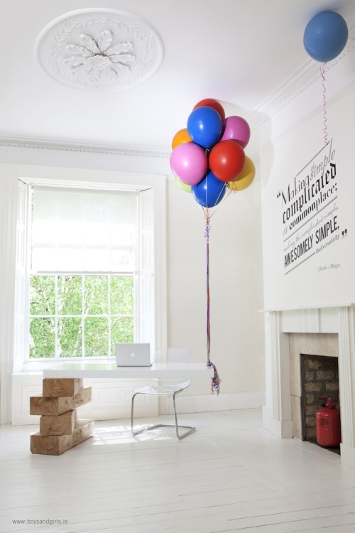 "modernizing:  Awesome Hot Air Balloon Desk Creative agency Boys and Girls worked with Twisted Image to come up with a whimsical desk that would make their reception area stand out. Permanent hot air balloons, strong enough to carry the weight of the desk, were created with a new type of rubber composite to make air-tight balloons that would never degrade. Caltech was even called upon to supply a helium/hydrogen hybrid gas with an atomic weight 150 times lighter than helium alone. Finally, those colorful ribbons are said to be ""reinforced with carbo-titanium"" and tied off on ""an aerospace grade titanium cleat."" For the finishing touch, giant Jenga blocks were carved with solid wood and placed on the other side."