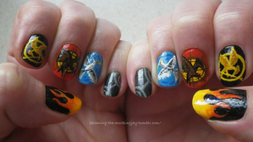 becoming-the-mockingjay:  More Hunger Games inspired nail art