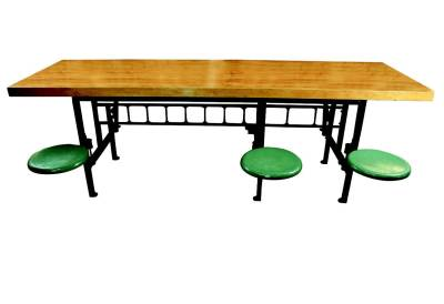 1940.  Industrial Lunch Table. From a factory in Chicago, this cool relique from the past is constructed of cast iron, steel and wood. The table has 6 seats that can swing in under the table or swing out for seating. Cast iron supports/brackets and porcelain enameled steel seats. American.