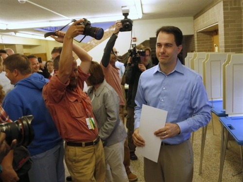 "Wisconsin Gov. Walker survives recall election ABC News, AP, CBS News, CNN, Fox News and NBC News have called the Wisconsin gubernatorial recall election for Gov. Scott Walker.  ""He becomes the first governor in U.S. history to survive a recall attempt with his defeat of Milwaukee Mayor Tom Barrett and the union leaders who rallied for months against his agenda."" - AP Photo via msnbc.com: Republican Wisconsin Gov. Scott Walker casts his vote on election day in Wauwatosa on June 5. (Darren Hauck / Reuters)"