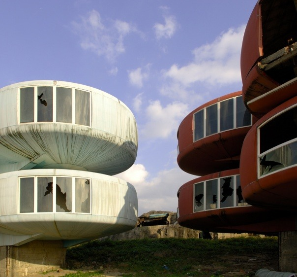 monocoleporter:  San Zhi, Taiwan was originally built as a futuristic resort destination. For some inexplicable reason it was never a success, and now all of the buildings are abandoned. As an interesting side note, you can see it on Google Maps.