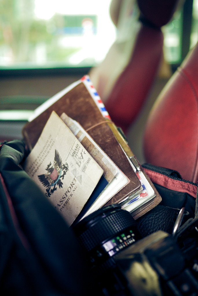 Traveler's Notebook and camera on big red airport bus couch - Seoul, Korea (by Patrick Ng)
