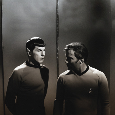 Speaking of Trek I love the above picture.  Not exactly sure what episode (if any) it's from.  It's like they stumbled upon some dark gritty corner of Victorian London, the Lost Generation era of 1920s Paris, or some dark alley in 1920s Shanghai or Calcutta (even though really they're just on the ship and the strange sheen of the corridor is making it seem like they're out in the fog or something).  Just lovely!