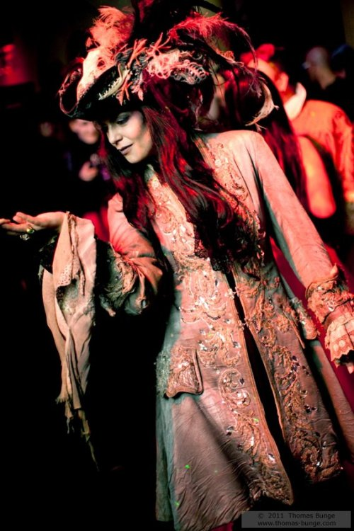 monster-rose:  madamecuratrix:  A gorgeously-costumed reveler from Danse Macabre, 2011. I covet that coat so, so much. Photo Credit: Thomas Bunge   This is Maren Sohnlein, the owner of Maskenzauber. As I recall, I was dancing with her when this picture was taken ;)