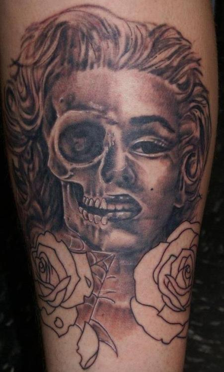 Here is my Marilyn Monroe tattoo, done by Grant Taylor at North Coast Body Mod, located on the front of my left leg. The idea came from me messing around on Photoshop with a picture of Marilyn, for fun. Once i was finished with the editing, i thought it would be great to have it on my body; permanently displaying the imagery of life and death of one of the golden ages most iconic persons.
