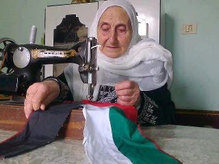 Oppressed and I prepare flags for the revolution in Syria.