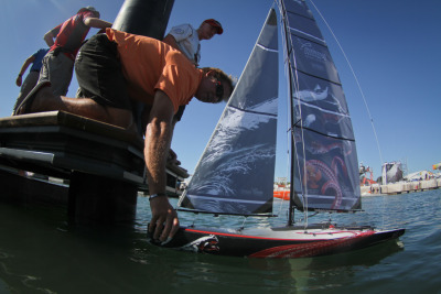 "pumasailing:  Skipper Ken Read was on hand to help ""Murph"" tune the mini-Mar Mostro before model boat racing."