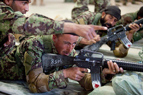 "PHOTO: New recruits in the Afghan National Army learn how to shoot M-16 rifles. (Melanie Stetson Freeman/Staff) After years of standing in the background, Beijing is starting to show signs of closer engagement with its strife-torn neighbor in a bid to ward off disaster, say Chinese and foreign analysts. When Afghan President Hamid Karzai meets his Chinese counterpart Hu Jintao here on Friday, they will raise their countries' bilateral relations to a ""new strategic level,"" an Afghan official told reporters in Kabul this week. READ: Why China is likely to get more involved in Afghanistan"