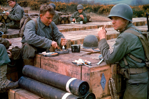 life:  American combat engineers eat a meal atop boxes of ammunition stockpiled for the impending D-Day invasion, May 1944. On the anniversary of D-Day, see Frank Scherschel's photographs from before and after D-Day in masterfully restored color here.